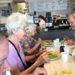 Cedar Lodge residents enjoying fish & chips in Honiton