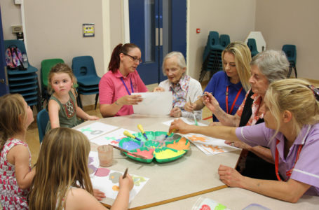 Immacolata House Care home Langport Residents painting with children at Little Pips Nursery