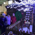 Residents and staff member admiring Christmas display at local farm