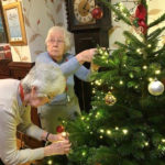 Residents decorating their chosen real Christmas tree at Cedar Lodge