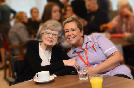 Resident smiling with care assistant at Casa di Lusso Dementia Nursing Home Bridgwater Somerset