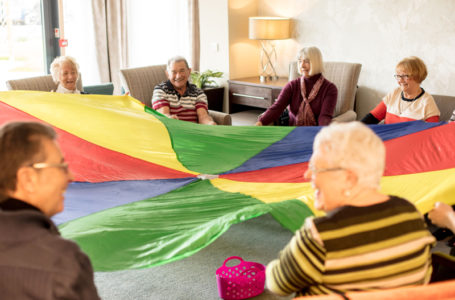 Residents playing the parachute exercise game at Casa di Lusso Care Home, Bridgwater