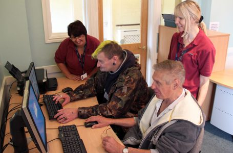 Residents and Notaro Support Workers on the computers at Serenita ARBD Care Home Weston Super Mare
