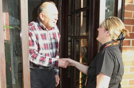 Notaro Homecare Ltd community carer greeting Service User at his front door