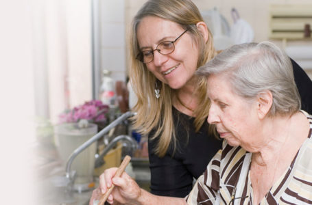 Notaro Care Homes Support Worker cooking with service user