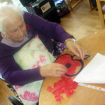 Resident making Poppy art
