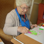 Resident colouring in her butterfly artwork