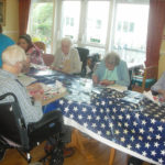 Residents making Poppy art with Creative Minds