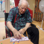 Resident playing bingo