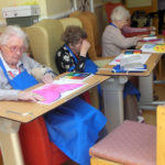 Residents colouring in their butterflies