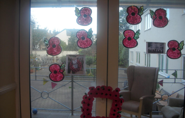 Clarence Park's window display of their home made poppy art and poppy wreath