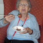 Resident enjoying chocolate covered strawberry