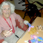 Resident flower arranging with home made playdough