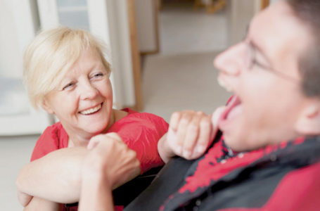 Care Assistant laughing with resident