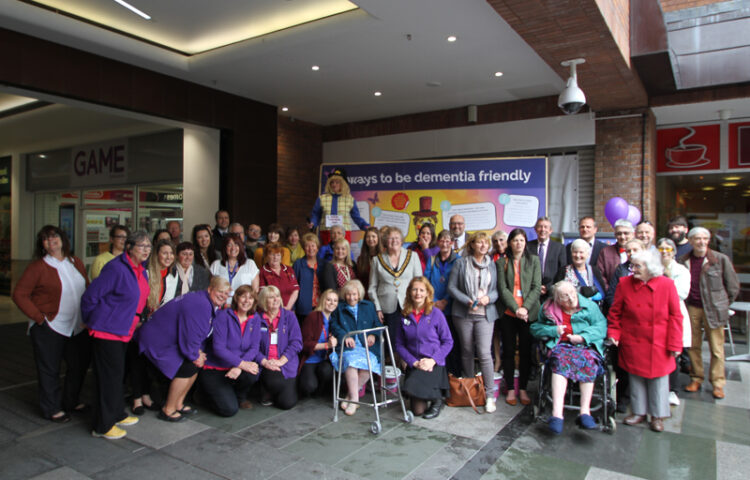 Reminiscence Learning staff, Archie pictured together with Notaro Care Home residents, other sponsors and attendees