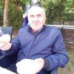Resident sat in the garden enjoying a cupcake