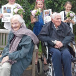Residents with Curry Rivel pupils and their Life Story books