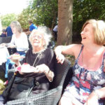 Resident and relative enjoying a joke together