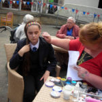 School pupil getting her face painted