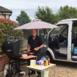 Immacolata House Maintenance Person, Ian, cooking burgers on the BBQ