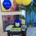 Table set up with St Margaret's Hospice Collection box, leaflets and balloons