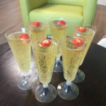 champagne glasses filled with fizz and a strawberry