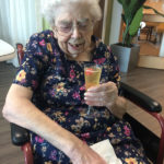 Casa di Lusso resident enjoying a glass of fizz in the beauty room