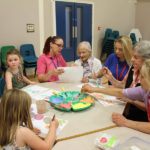 Little Pips children, Room supervisor - Lorainne Gill, residents - Georgie & Pam, Activities- Emma and Care Assistant - Caroline, all getting involved with painting