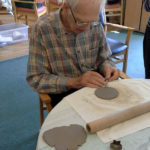 Resident making his clay cake