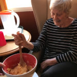 Cedar Lodge resident mixing the cake mix