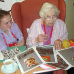 Clarence Park Resident and staff choosing they style of cake they would like to bake