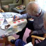 Resident & relative making pumpkin prints