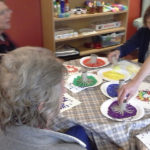 residents making firework paintings with toilet cut up cardboard toilet roll tubes