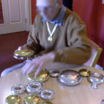 Resident stacking gold and silver pebbles
