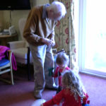 Resident playing games with the little pips children