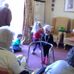 Residents playing games with the little pips children