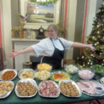 Kitchen Assistant showcasing the large buffet lunch laid out