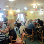 Immacolata House residents and loved ones sat at their tables enjoying the Christmas Party Buffet Lunch