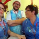 Immacolata House staff wearing festive head gear