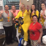 Casa di lusso staff in their pajamas with Louise on the exercise bike