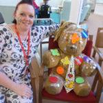 La Fontana staff member in her pajamas with their teddy bear