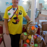 Activities coordinator wearing her Pudsey Bear tshirt with their teddy bear