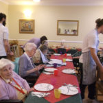 Residents and loved ones enjoying the buffet