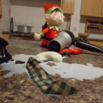 Christmas Elf melting Frosty the Snowman with the hair dryer!
