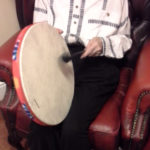 Resident playing the drum
