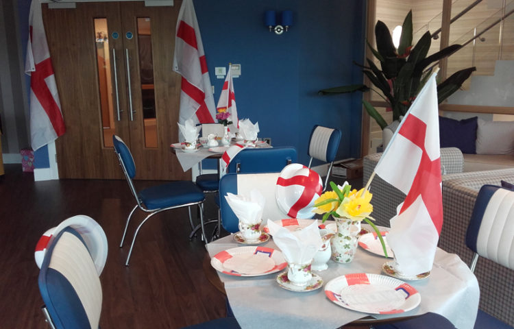 Casa di Lusso's diner dressed for St George's Day tea party