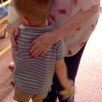 Little Pips child hugging resident