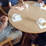 Little pips and Immacolata House residents enjoying cake from Old Oak Farm together