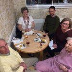 residents and loved ones enjoying the cheese and wine evening