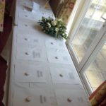 Past residents names laid out with a candle each, on the table during the remembrance service